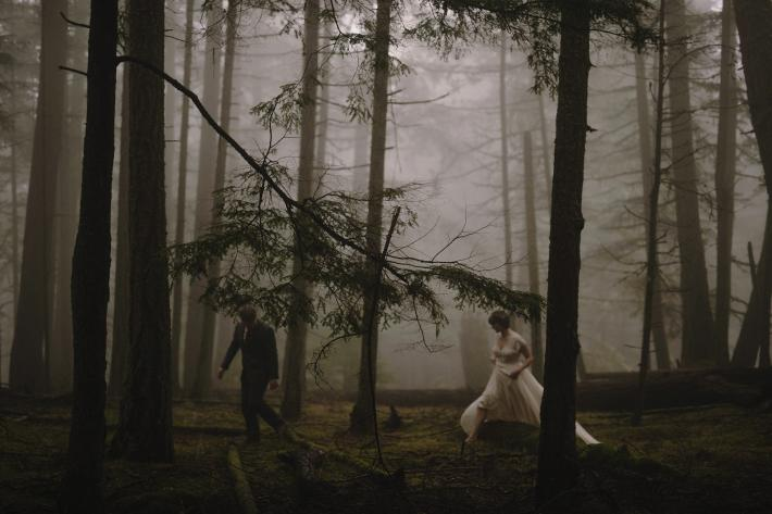 Ethereal photo of wedding couple walking through the woods at Mt. Constitution - Kristen Marie Parker