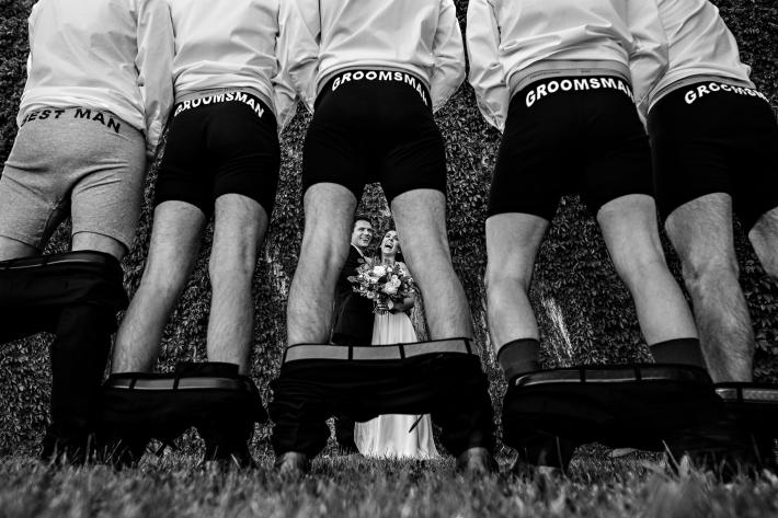 Groomsmen pulls their pants down to show off printed boxers - photo by Moore Photography