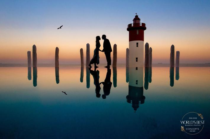 Silhouette of couple at lighthouse by Jacki Bruniquel - South Africa