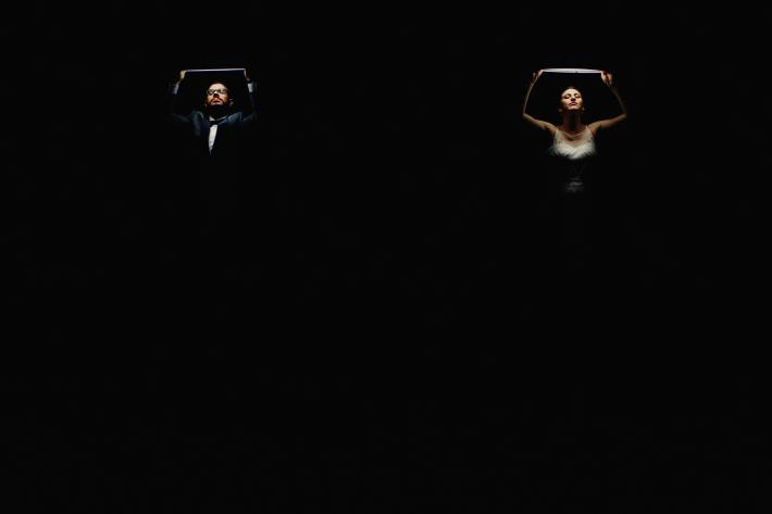 Featured bride-and-groom-holding-lights-over-faces-low-key-portrait-worlds-best-wedding-photos-fer-juaristi-mexico-wedding-photographers