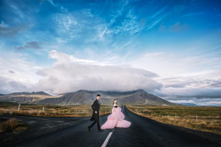 Bride in pink tulle gown and groom in black morning suit - photo by Edwin Tan - Malaysia