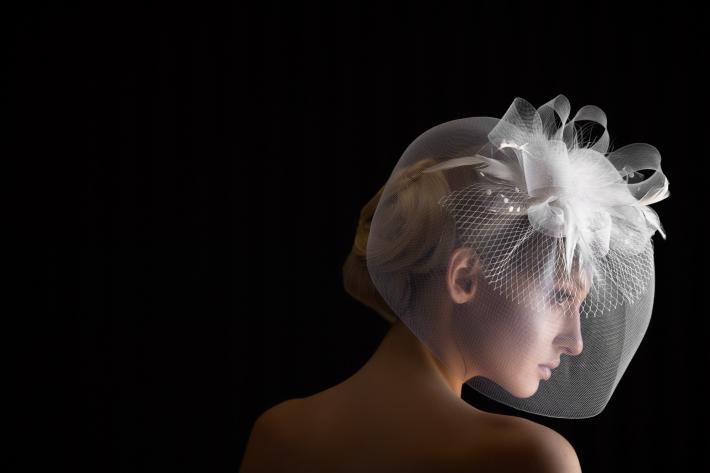 Bride in ribboned birdcage wedding veil - photo by Jerry Ghionis - Las Vegas