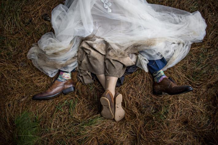 Bride and groom on barn floor - photo by Jacki Bruniquel