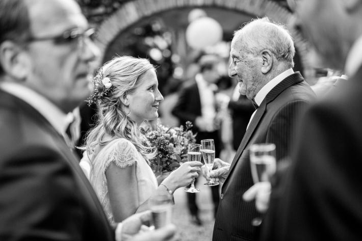 Bride and grandfather share tearful smiles and wedding reception - photo by Sylvain Bouzat - France