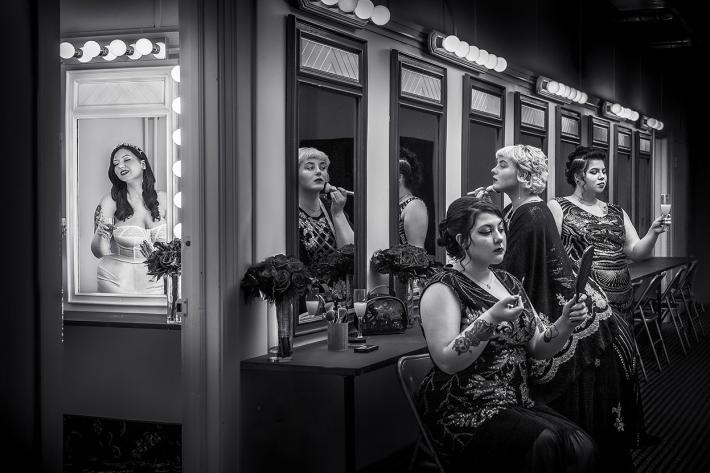 Black and white timeless photo of bridal party getting ready in mirror - Amber Henry - Michigan