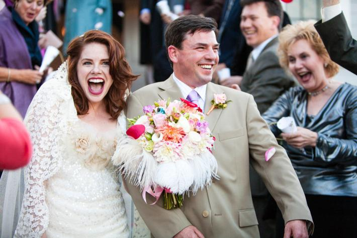 featured-estatic-red-haired-bride-feather-bouquet-lace-dress-groom-in-taupe-suit-worlds-best-wedding-photos-san-juan-island-photographers-la-vie-photo