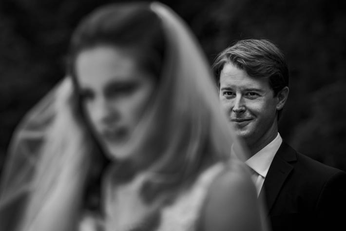 groom-gazing-at-bride-from-behind-viridian-images-photography