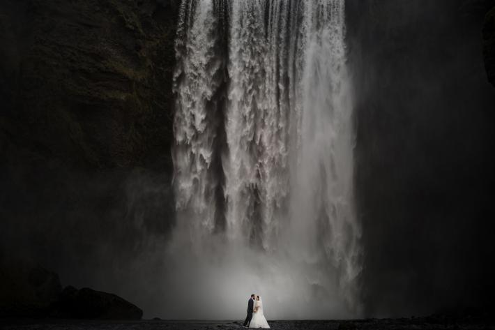 Skogafoss- Iceland-dramatic-bride-and-groom-shot-by-waterfall-susan-stripling-nyc-wedding-photographer