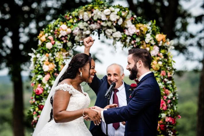 bride-and-groom-pronounced-husband-and-wife-joyfully-photo-by-hannah-photography