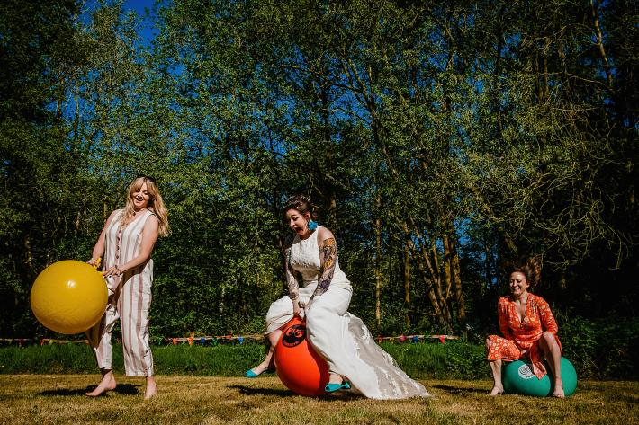 hilarious-shot-of-bride-and-friends-on-bouncy-balls-emma-rich
