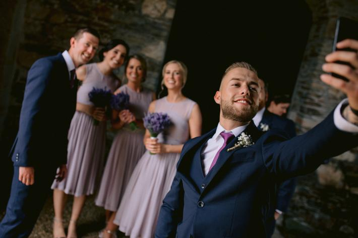 groomsman-taking-a-selfie-with-others-the-portrait-rooms