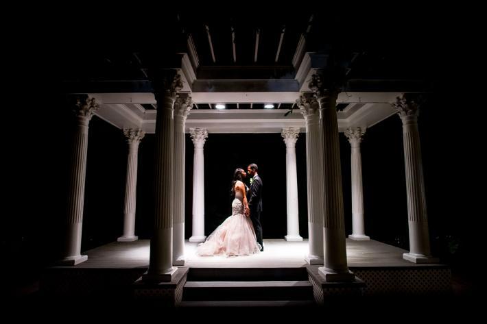 nighttime-bride-and-groom-portrait-under-gazebo-photo-by-adibe-photography