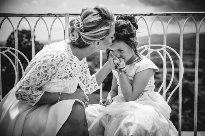 bride-kisses-little-girl-julien-laurent-georges
