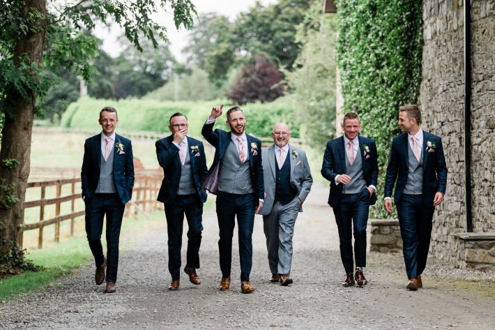 groomsmen-and-father-on-country-road-ireland-the-portrait-rooms