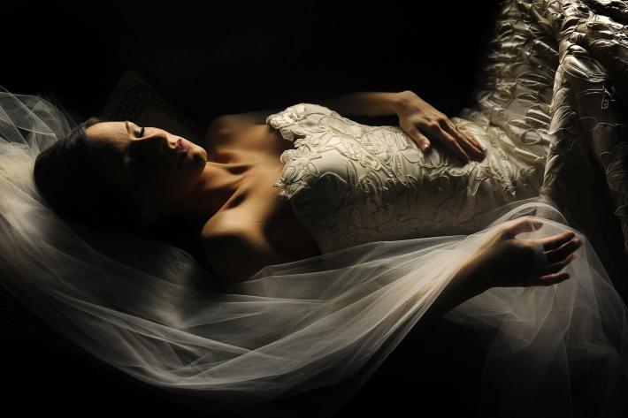 sleeping-bride-portrait-soft-window-light-applique-gown-worlds-best-wedding-photos-daniel-aguilar-houston-wedding-photographers