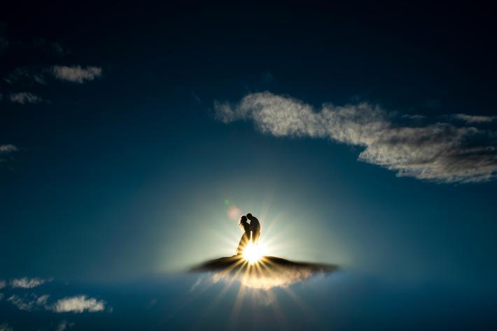 Couple walking on sunlit clouds - award-winning engagement photo by J. LaPlante - Colorado