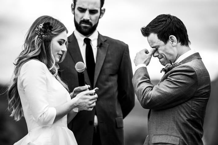 groom-hods-back-tears-during-ceremony-j-la-plante-photo