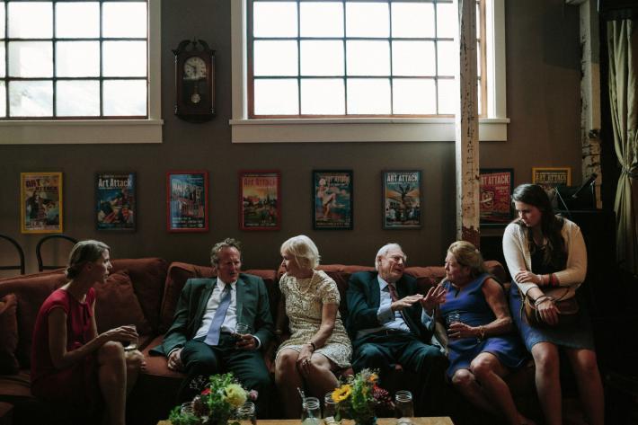 seated-family-talking-jonas-seaman-photography-seattle