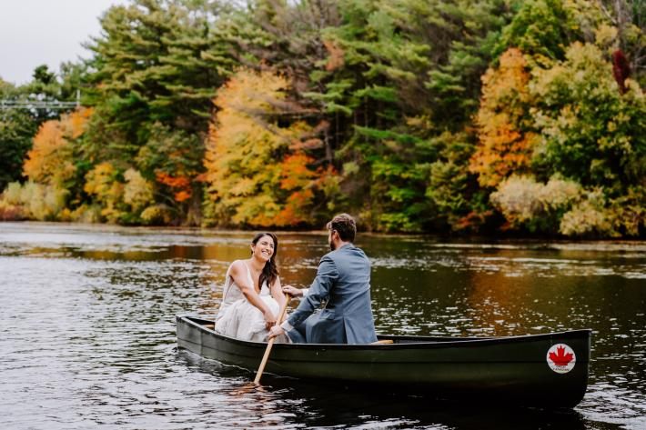 couple-in-canoe-on-lake-in-autumn-all-the-little-stories-photography