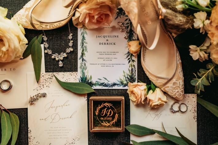 flat-lay-with-shoes-stationery-rings-and-flowers-mike-zawadzki-photography
