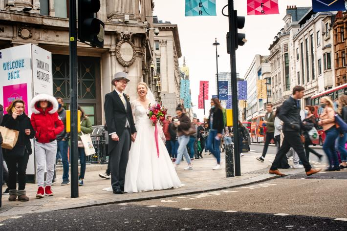 Just married couple on busy London street - photographed by Andrew Billington