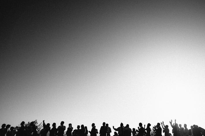 silhouette-group-shot-against-big-sky-bradley-hanson-photography